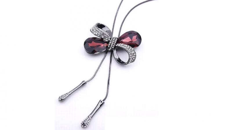 N470 Long purple crystal bow necklace